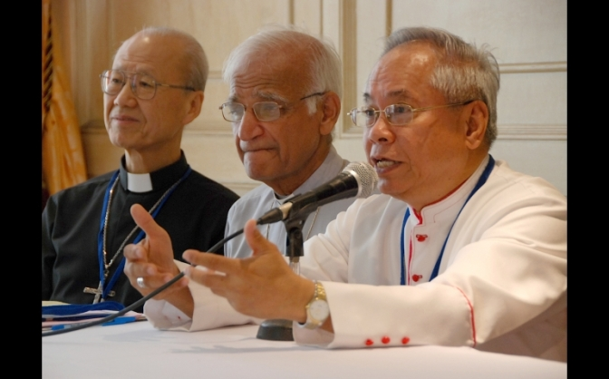 Cardinal-designate Orlando Quevedo addresses a press conference for the 9th Federation of Asian Bishops' Conferences plenary assembly in 2009 in Manila. Pakistan Archbishop Lawrence John Saldanha of Lahore and now-Cardinal John Tong Hon of Hong Kong look on. (Roy Lagarde/national catholic reporter}