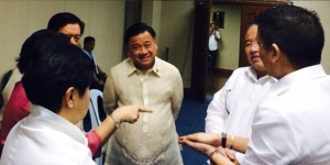 DAVAO CITY REp. ISIDRO UNGAB, center, with fellow congressmen discussing crucial legislative directions