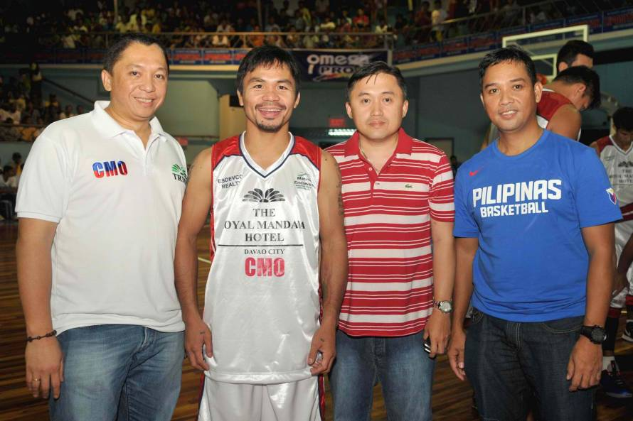 """Mayor Rodrigo Duterte's executive assistant Christopher Lawrence """"Bong"""" Go, 2nd from right, with boxing icon and Sarangani Rep. Manny Pacquiao, to his right, who played for The Royal Mandaya Hotel-City Mayor's Office (TRMH-CMO) team in the 28th Kadayawan sa Dabaw Invitational Basketball Tournament, one of the highlights of Kadayawan sa Dabaw 2013. At left is TRMH president Glenn Escandor; at right is PSupt, Alden Delvo."""